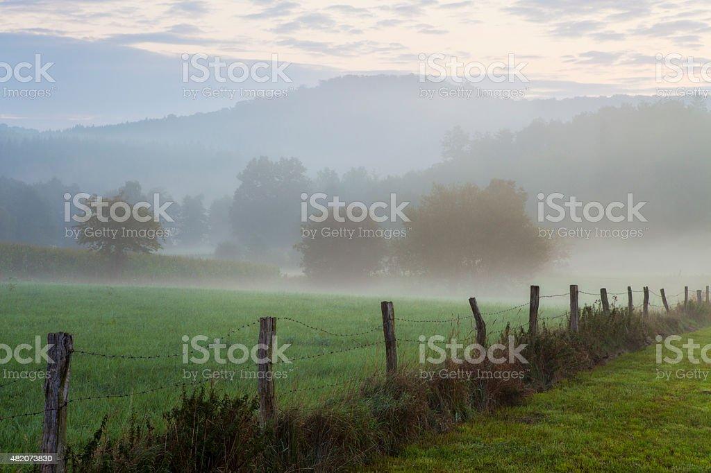 Idyllic misty landscape at sunrise, fog, Sauerland, Germany, countryside, meadow stock photo
