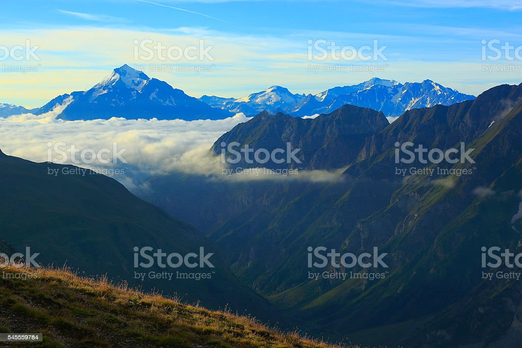 Idyllic Mont Blanc Alpine landscape sunrise above clouds and valley stock photo
