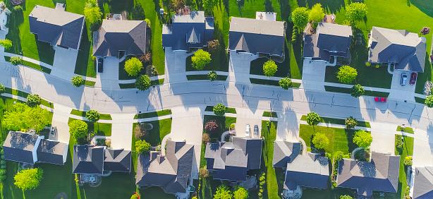 istock Idyllic neighborhood street, aerial view 856713604