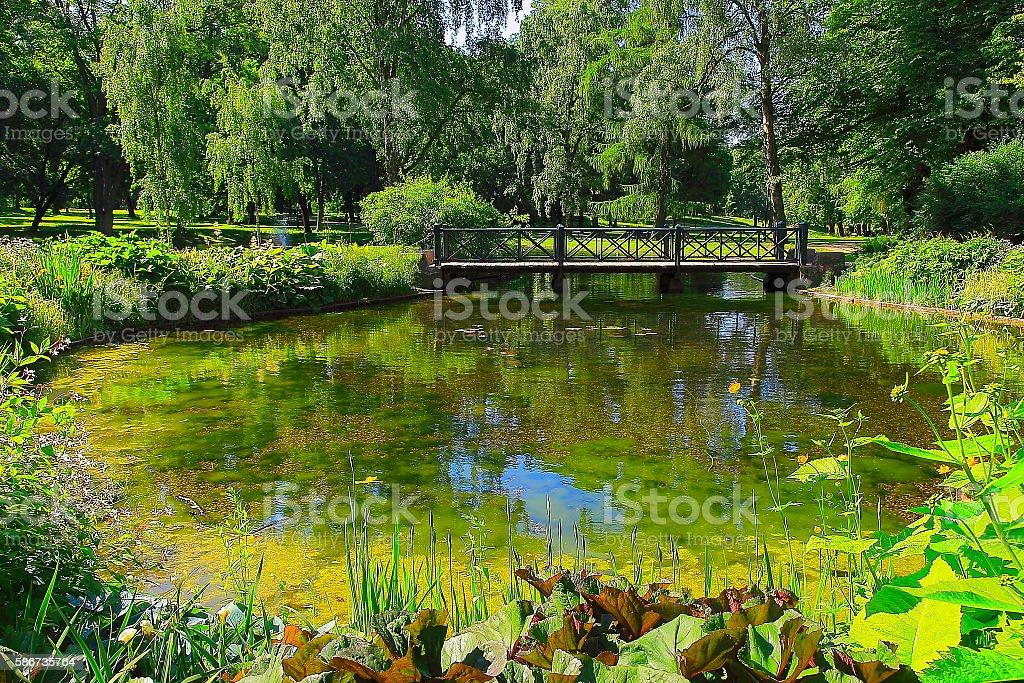 Idyllic Norwegian park, bridge, lake reflection landscape, Oslo, Norway, Scandinavia stock photo