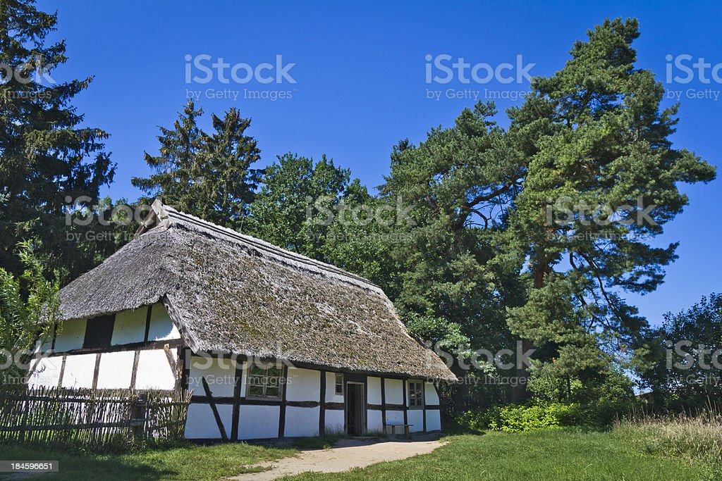 Idyllic old log Cabin in the summer royalty-free stock photo