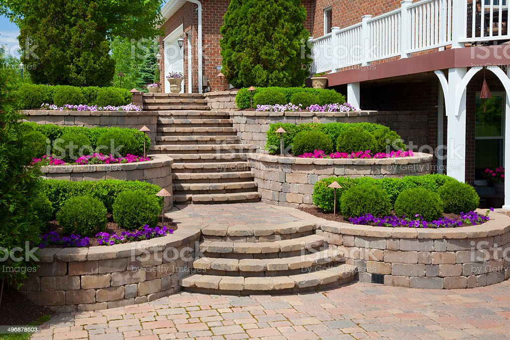 Idyllic Paved Landscaping, Stairs With Terraced Shrubs and Flowerbeds stock photo