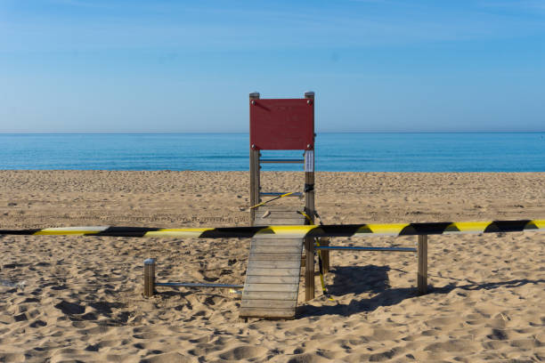 Idyllic playground on a beach closed down to prevent the spread of the coronavirus. 2020 coronavirus pandemic closed down all beaches and parks. stock photo