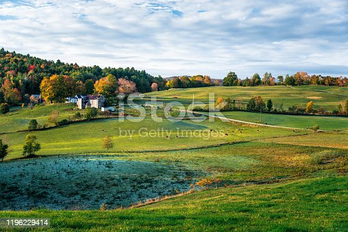 488912426istockphoto Idyllic rolling rural landscape at sunrise 1196229414