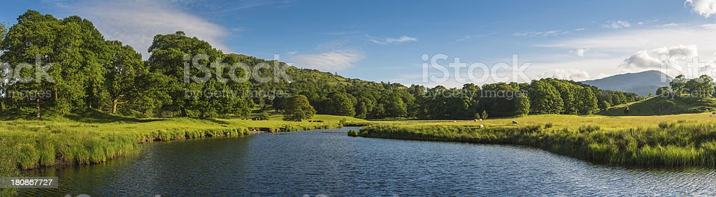 Idyllic rural landscape water meadows green summer hills panorama stock photo