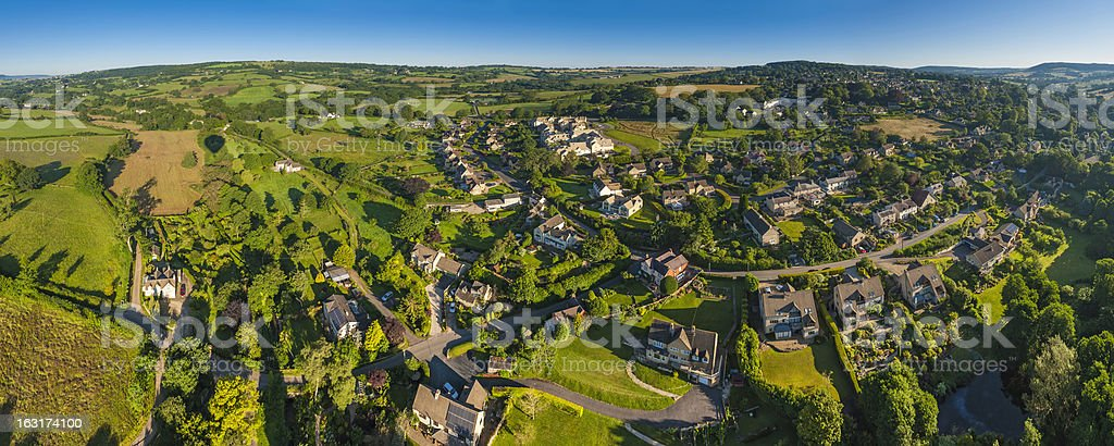 Idyllic rural village homes in green summer landscape aerial panorama stock photo