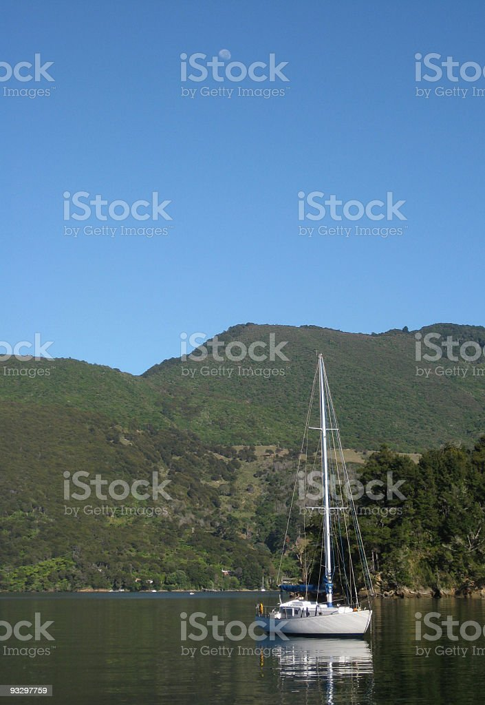 Idyllic scene of sail boat with moon above royalty-free stock photo