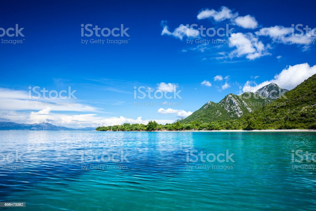 Idyllic seascape - Island, crystal clear Adriatic Sea and Blue Sky with White Clouds - Royalty-free Adriatic Sea Stock Photo