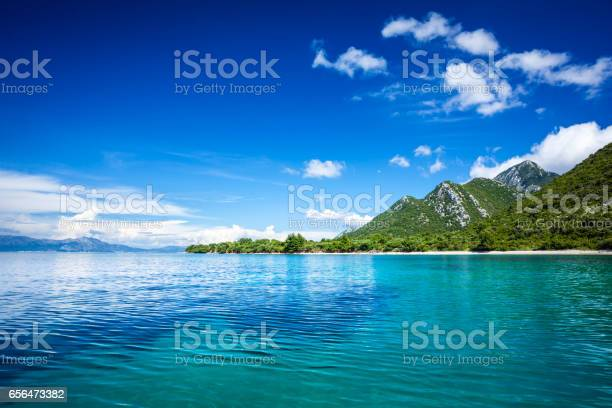 Idyllic Seascape Island Crystal Clear Adriatic Sea And Blue Sky With White Clouds Stock Photo - Download Image Now