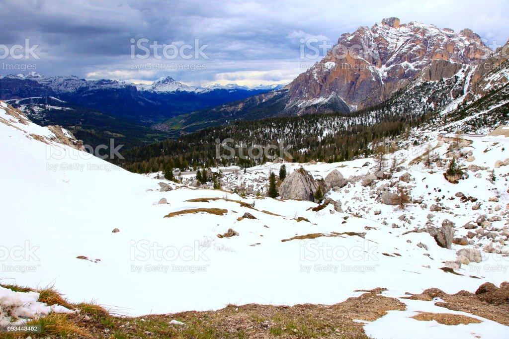 Idyllic Snowcapped Lagazuoi, Falzarego pass,  Dolomites mountain range, majestic storm clouds panorama, Italy tirol alps stock photo