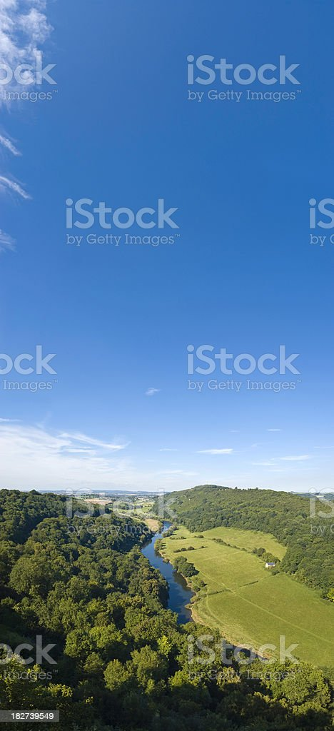 Idyllic summer forest green valley pasture Symonds Yat UK panorama stock photo
