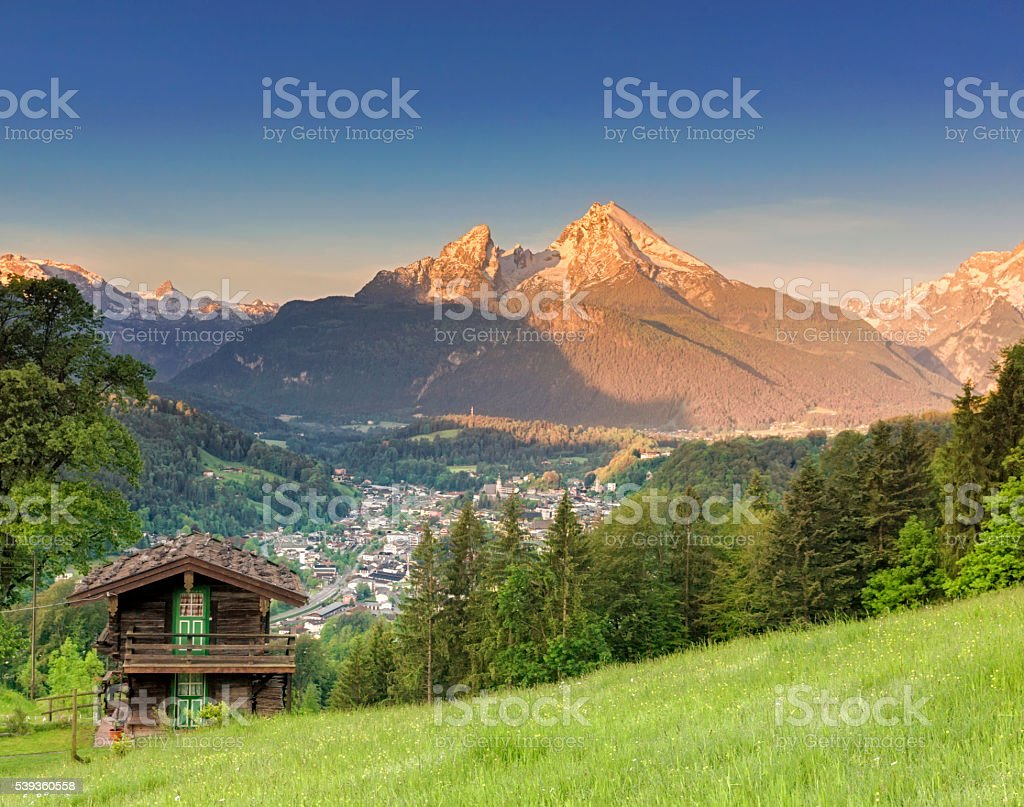 Idyllic summer landscape in the Alps at sunrise stock photo