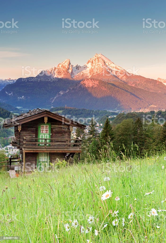 Idyllic summer landscape in the Alps at sunrise stock photo