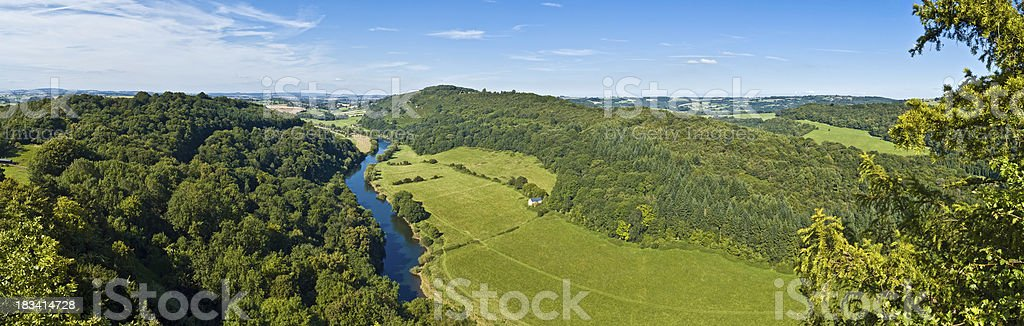 Idyllic summer river green forest valley panorama stock photo