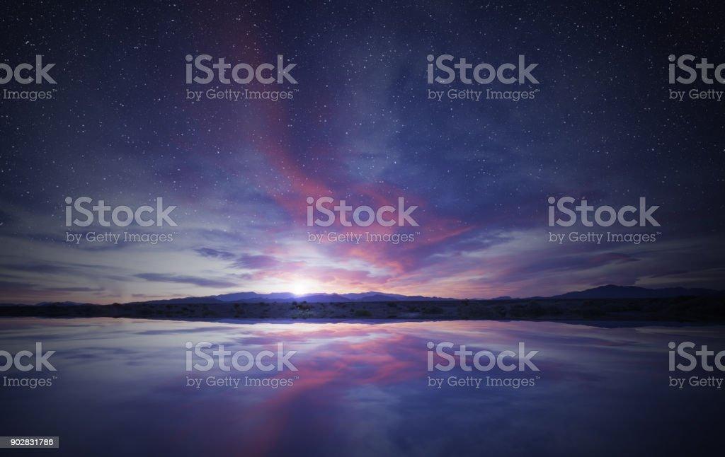 idyllic sunrise in the sky reflecting on water stock photo