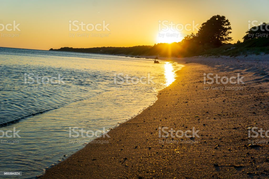Idyllic sunset at the beach in Bornholm, Denmark on a day in summer royalty-free stock photo