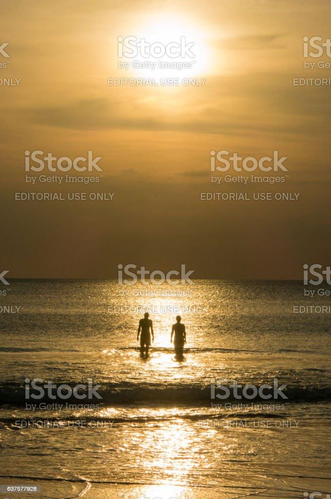 Idyllic Sunset Beach Relationship Couple Walking Together stock photo