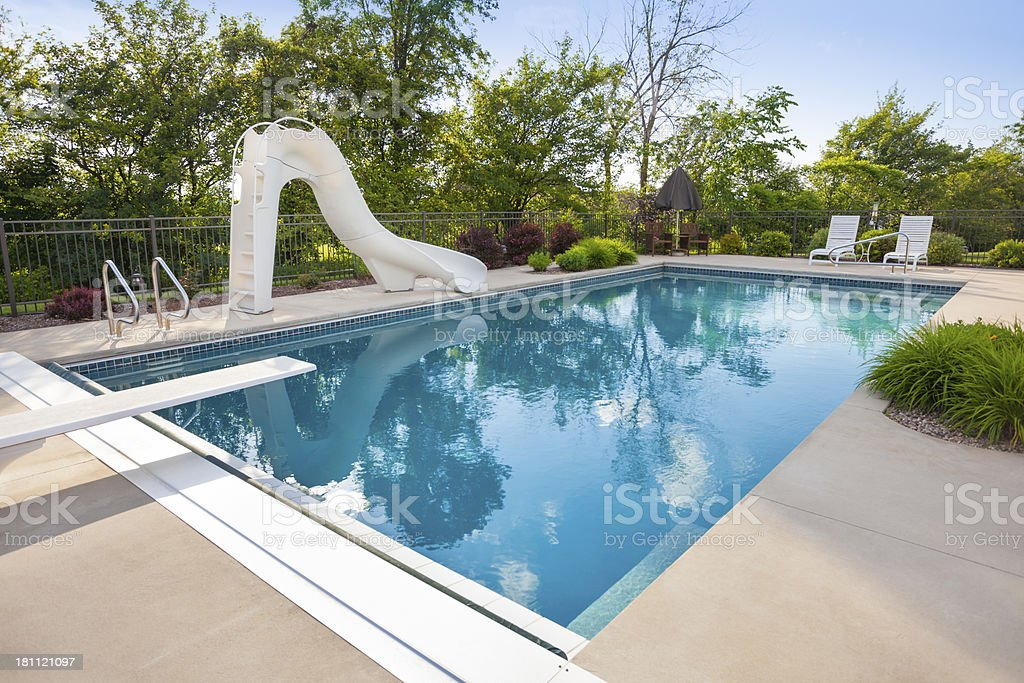 Idyllic Swimming Pool With Slide Diving Board Stock Photo - Download ...