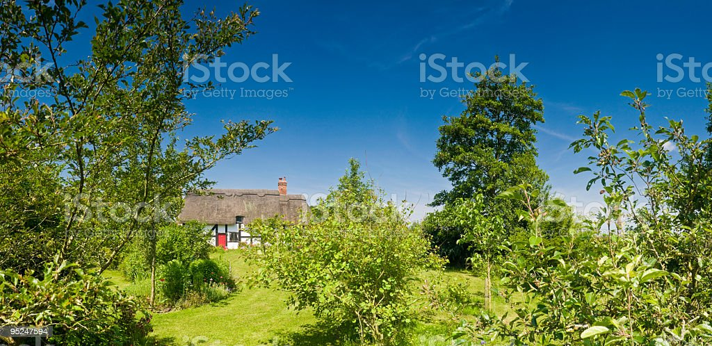 Idyllic thatched cottage garden royalty-free stock photo