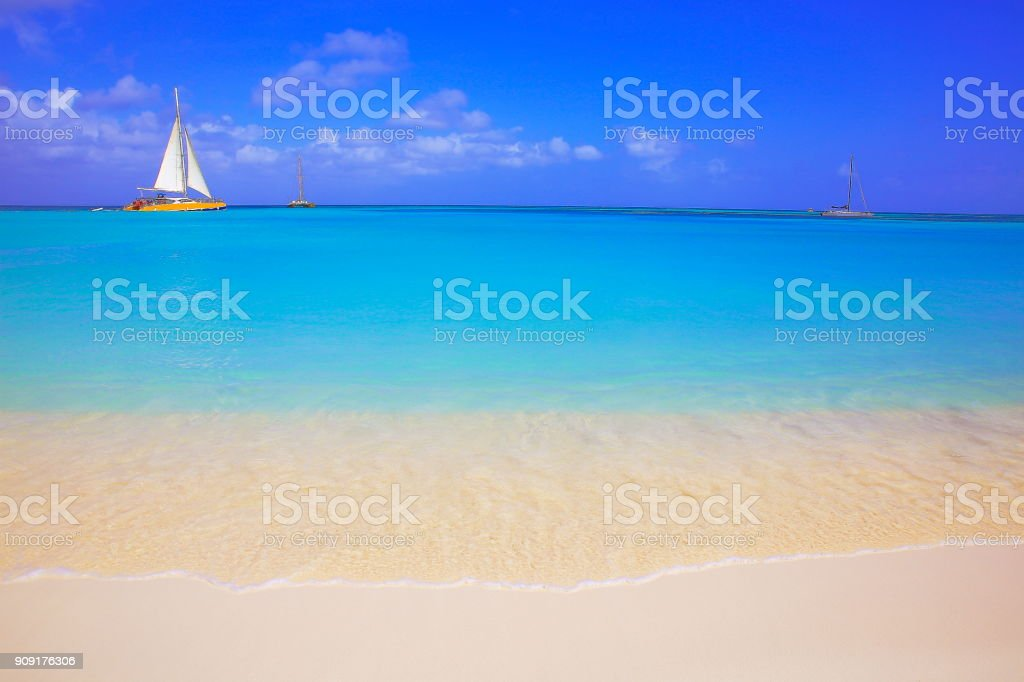 Idyllic tropical Beach with sailboat yacht sailing, Bahamas summer paradise, Caribbean sea stock photo