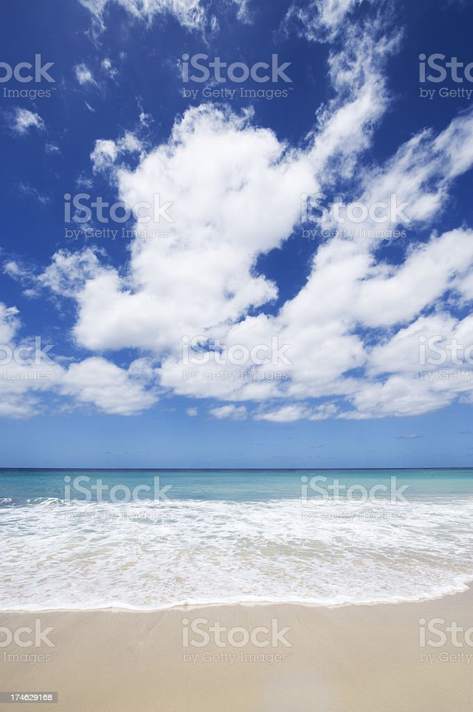 Idyllic Tropical Beach with Sea and White Clouds stock photo