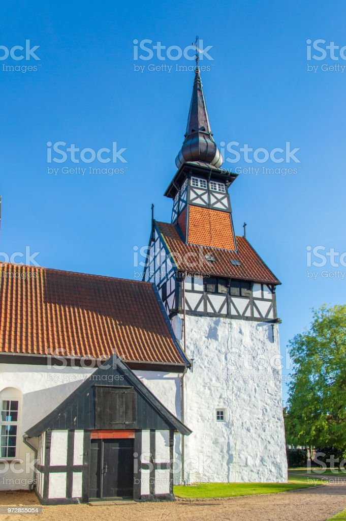 Idyllic view of Danish church in Nexø, Bornholm, Denmark on a day in summer stock photo