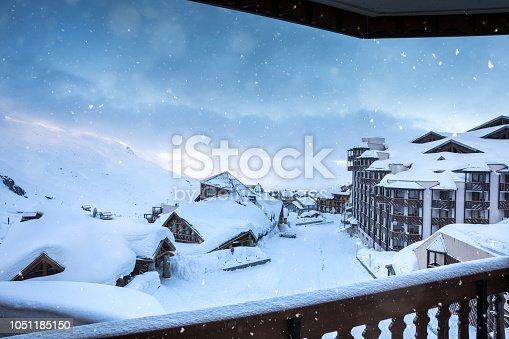 Morning snowfall in ski village in Val Thorens (France).