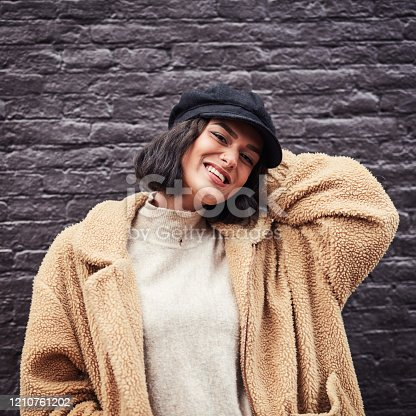 135359671 istock photo If anything completes her look it's her hat 1210761202