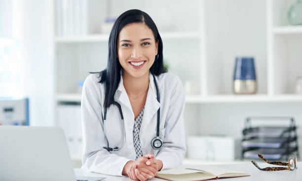 If it matters to you it matters to me Portrait of a young doctor working at her desk female doctor stock pictures, royalty-free photos & images