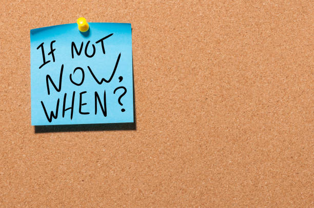 If Not Now, When Inspirational message pinned on office cork board If Not Now, When Inspirational message pinned on office cork board. taking the plunge stock pictures, royalty-free photos & images