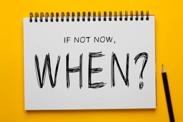 If Not Now, When? If Not Now, When? written on notepad with pencil on yellow background. Motivational concept. encouragement stock pictures, royalty-free photos & images
