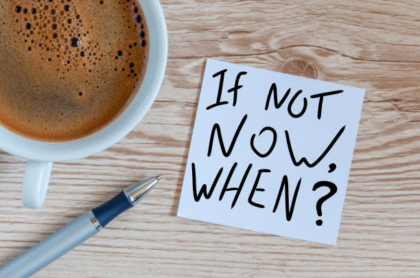 if not now when, text on note paper. motivating and inspiring question - deadline stock pictures, royalty-free photos & images