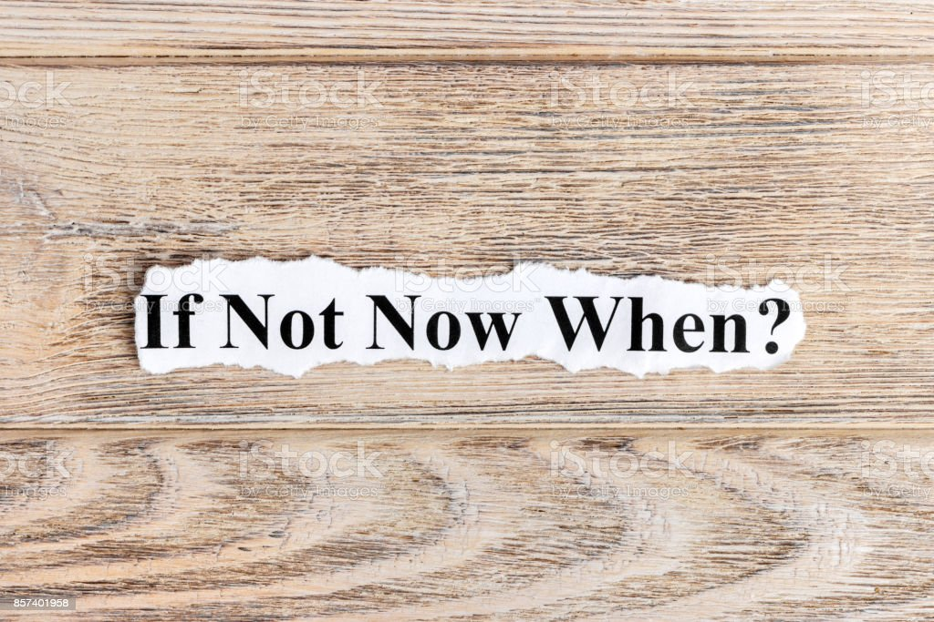 if not now when text on paper. Word if not now when on torn paper. Concept Image stock photo