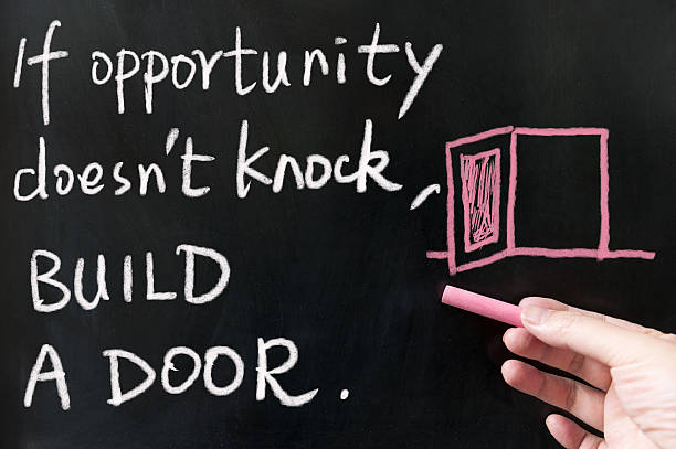 If opportunity doesn't knock, build a door stock photo