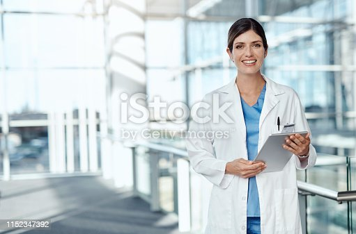 Cropped shot of a medical practitioner using a digital tablet in a hospital