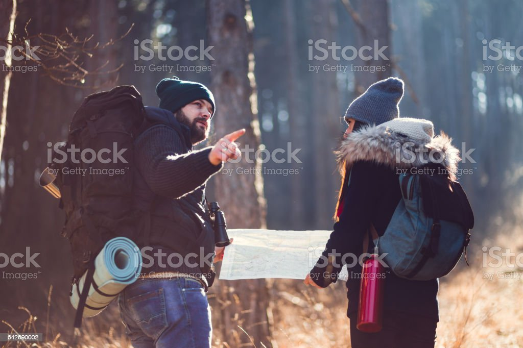 People Having a Discussion In Sunny Woods On Cold Winter Day....