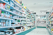 Cropped shot of fully stocked shelves in an aisle of a pharmacy