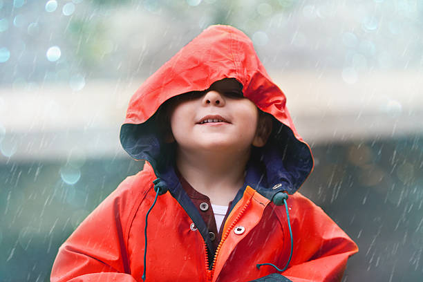 If you think the weather's cool, check me out Shot of an adorable little boy playing outside in the rainhttp://195.154.178.81/DATA/i_collage/pi/shoots/783464.jpg waterproof clothing stock pictures, royalty-free photos & images
