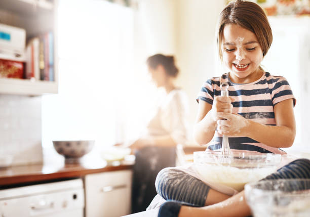 if you want a treat, you've gotta whisk for it - kids cooking stock photos and pictures