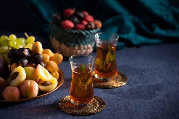 Iftar arrangement with fresh fruits, sweets and tea