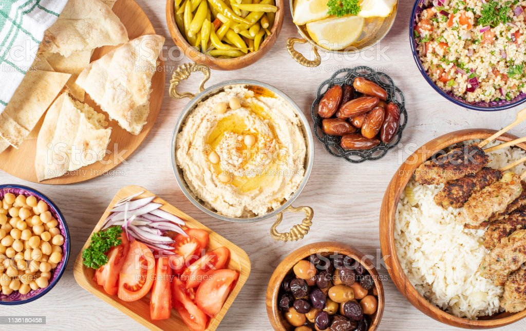 Iftar food table. Evening meal for Ramadan. Arabic cuisine. Middle Eastern traditional lunch. Assorted of Egyptian oriental dishes. Top view stock photo