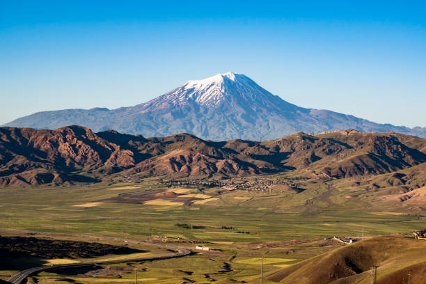 Igdir, Turkey, Middle East: breathtaking view of Mount Ararat, Agri Dagi, the highest mountain in the extreme east of Turkey accepted in Christianity as the resting place of Noah's Ark, a snow-capped and dormant compound volcano stock photo