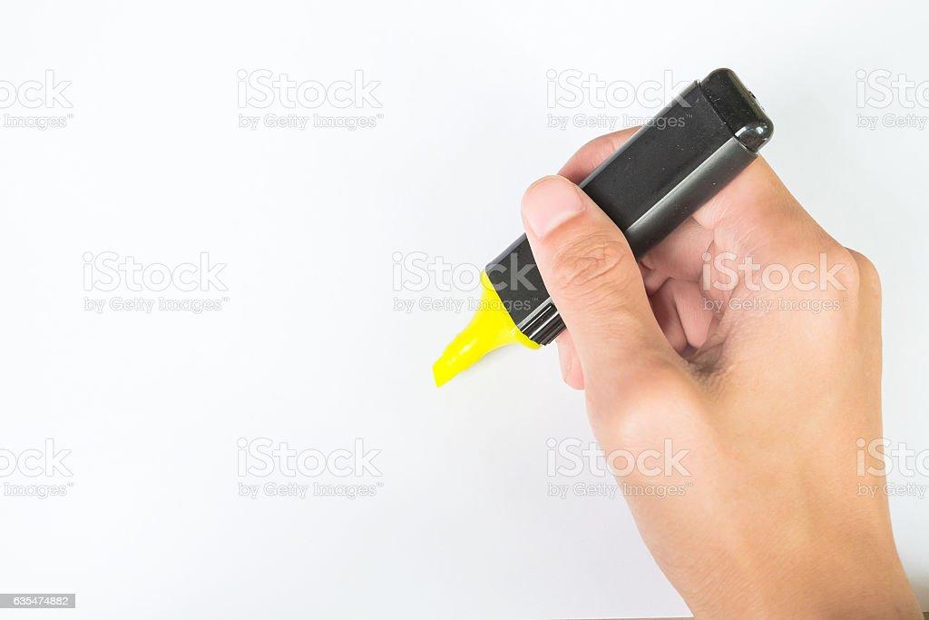 ight hand use yellow highlight pen stock photo