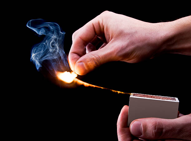 Igniting a Match stock photo
