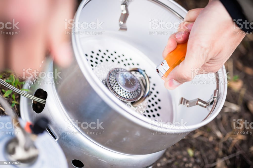 Igniting of outdoor gas cooker stock photo