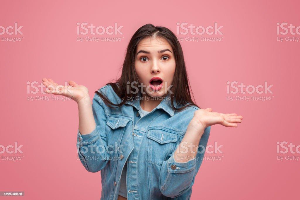 Ignorant expressive girl with hands apart zbiór zdjęć royalty-free