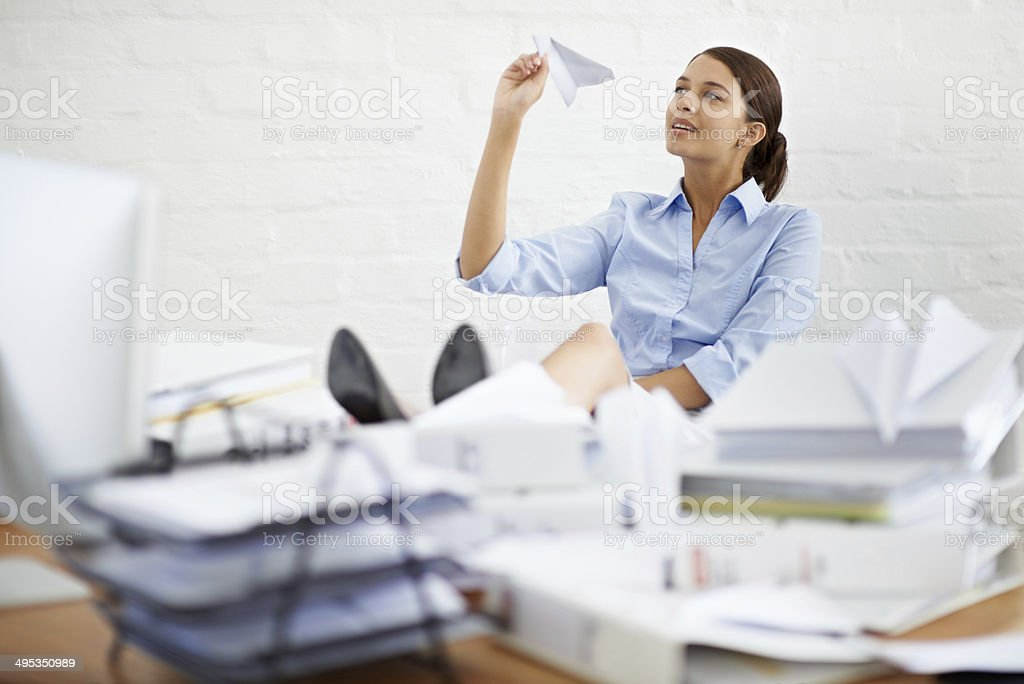 Ignoring the paperwork... by making paper planes stock photo