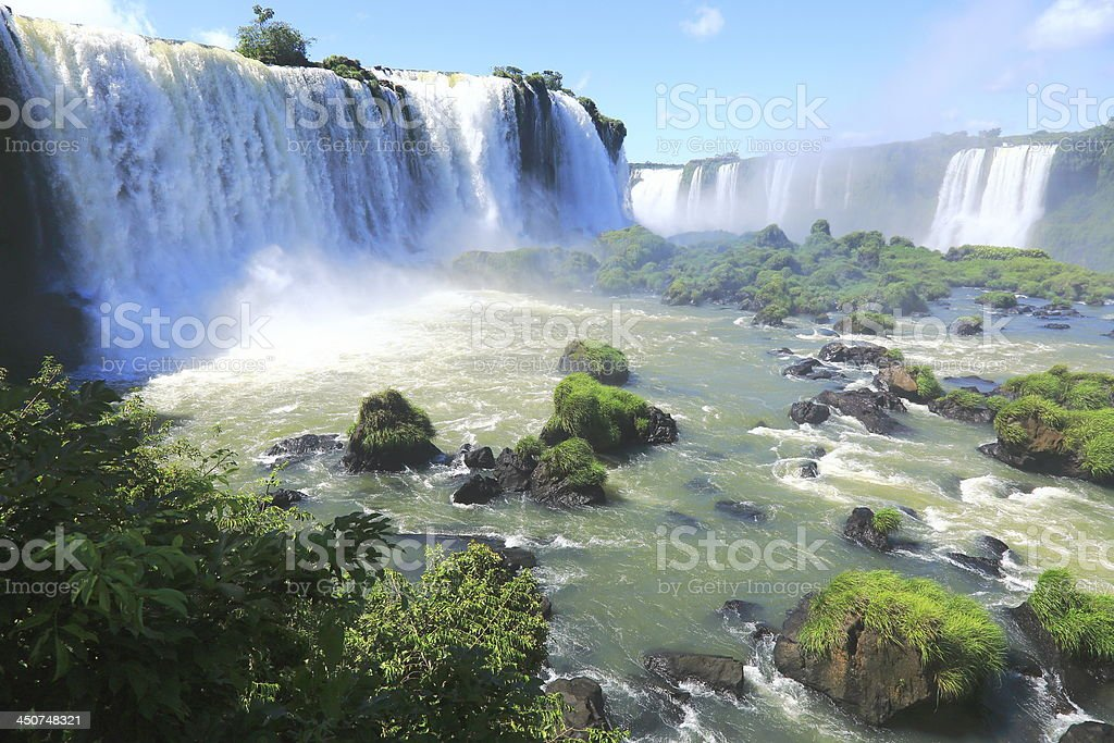 Iguacu Falls at sunlight and green rainforest, Brazil, America stock photo