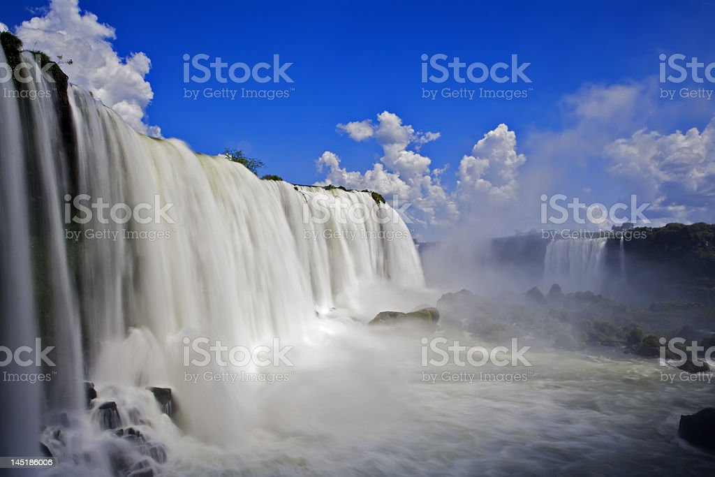 Iguassu waterfalls on a bright and sunny day stock photo