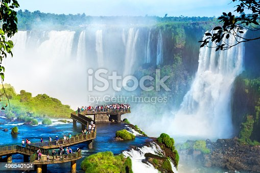 Tourists at Iguazu Falls, one of the world's great natural wonders, on the border of Brazil and Argentina.